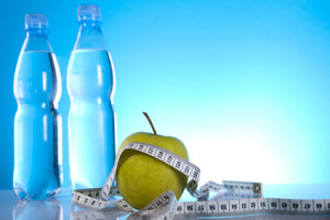 bottles of water and green apple