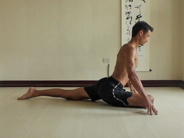 a man doing a pig pose which benefits his sexual health